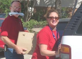 volunteers loading a van