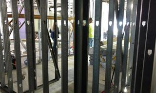 The framework is in for some of the new walls and the future new security area.