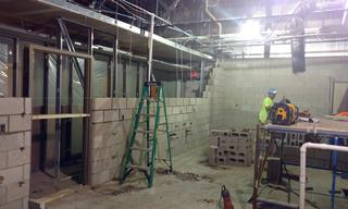 Take a look!  What was once a dirt floor, is now filled with new cement flooring, new plumbing, and the new-no-longer-drywall walls are being installed.