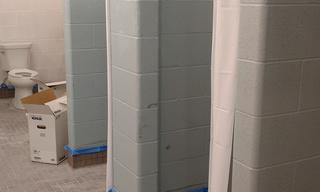 The new showers are ready to go in the men's restroom.  No more drywall, no more metal stalls.  Sparkling new.