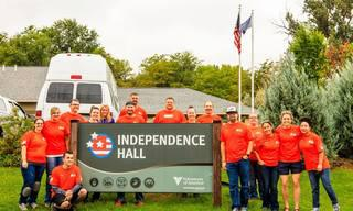 Home_20Depot_20Volunteers_20in_20front_20on_20Independence_20Hall_20Sign_20-_20VOA_20Northern_20Rockies.jpg