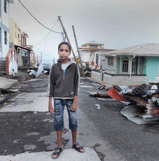 A child in the aftermath of Hurricane Maria - small