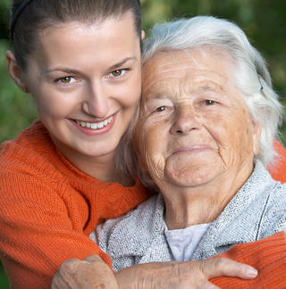 An adult granddaughter hugging her grandmother - small