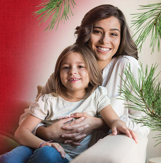 Mother and daughter with a holiday-themed background  - small
