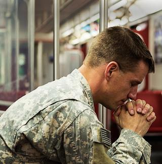 Sad solider sitting on a train - sml