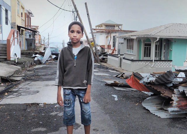 A child in the aftermath of Hurricane Maria