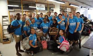 Volunteer_20group_20poses_20with_20backpacks_20and_20supplies.jpg