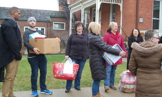 Thank you to volunteers from Oswald Companies who helped deliver gifts to families