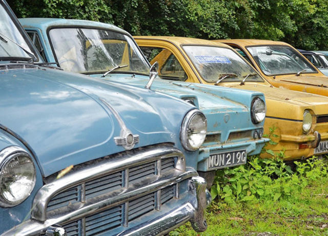 Older cars in a field