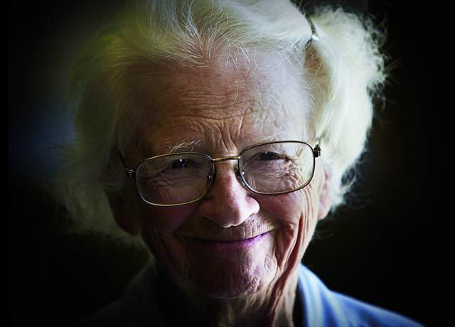 Female senior citizen smiling at the camera 640 x 460