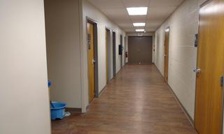 You saw this view before … only, it was missing the ceiling, floor, walls, and well, everything!  Today you are looking down the hallway where there are new restrooms on the right and soon to be updated laundry and family restrooms on the left.