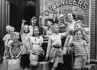 Historic images of kids waving in front of a Volunteers of America window sign