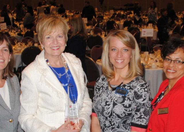 President and Chief Executive Officer Paula Hart (third from left) received the Jean Harris award from the Women's Health Leadership Trust.
