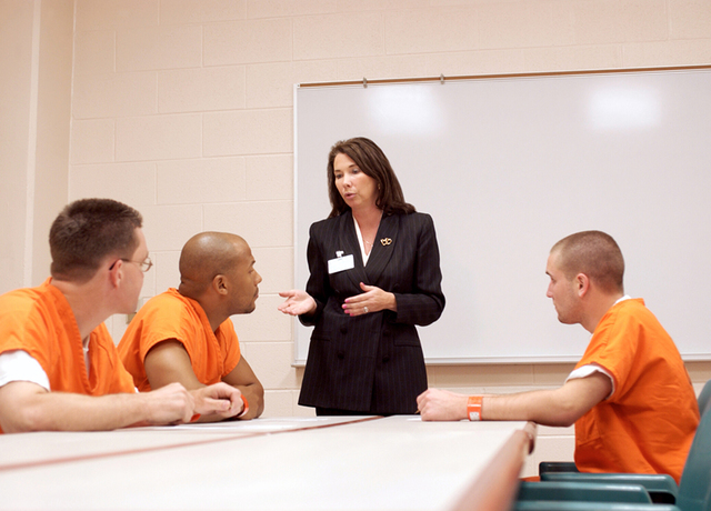 inmates sitting in a class