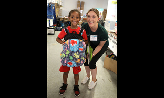 Prologis-volunteer-and-smiling-child_20copy.jpg
