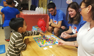 Child-and-his-mom-play-Candyland-with-ThankView-volunteers-smm.jpg