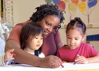 Volunteer-helping-kids-draw.jpg