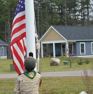 Cub Scout raising flag