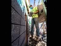 Logan Dyson with Spilker Masonry Co., works on an exterior wall of the new Hope House women's shelter under construction at 1301 W. Third Ave. (Colin Mulvany/THE SPOKESMAN-REVIEW)