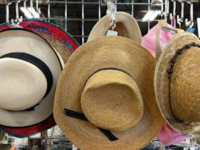 Sun hats at a Volunteers of America thrift store.