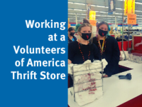 Working at a Volunteers of America Thrift Store. Two girls in black shirts and black masks at a white counter in a VOA Thrift Store.