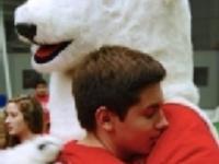 student hugging Bowdoin Bear