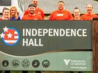 Home Depot Volunteers in front of Volunteers of America Northern Rockies' Independence Hall Sign