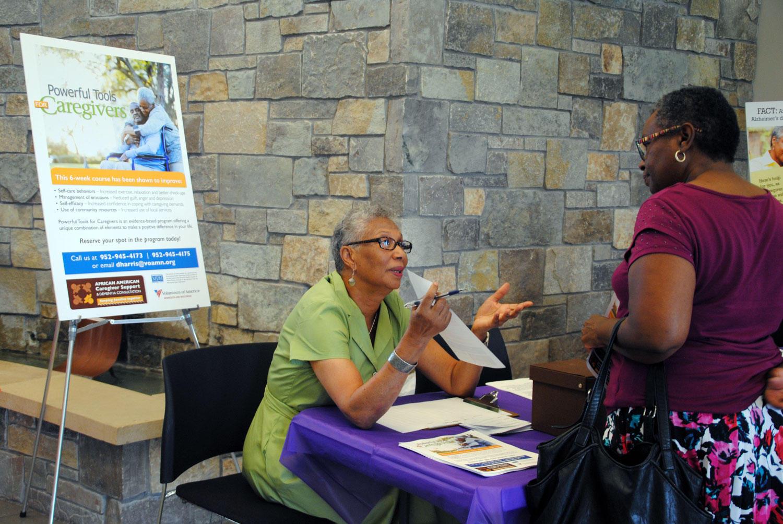 caregiver providing information at event
