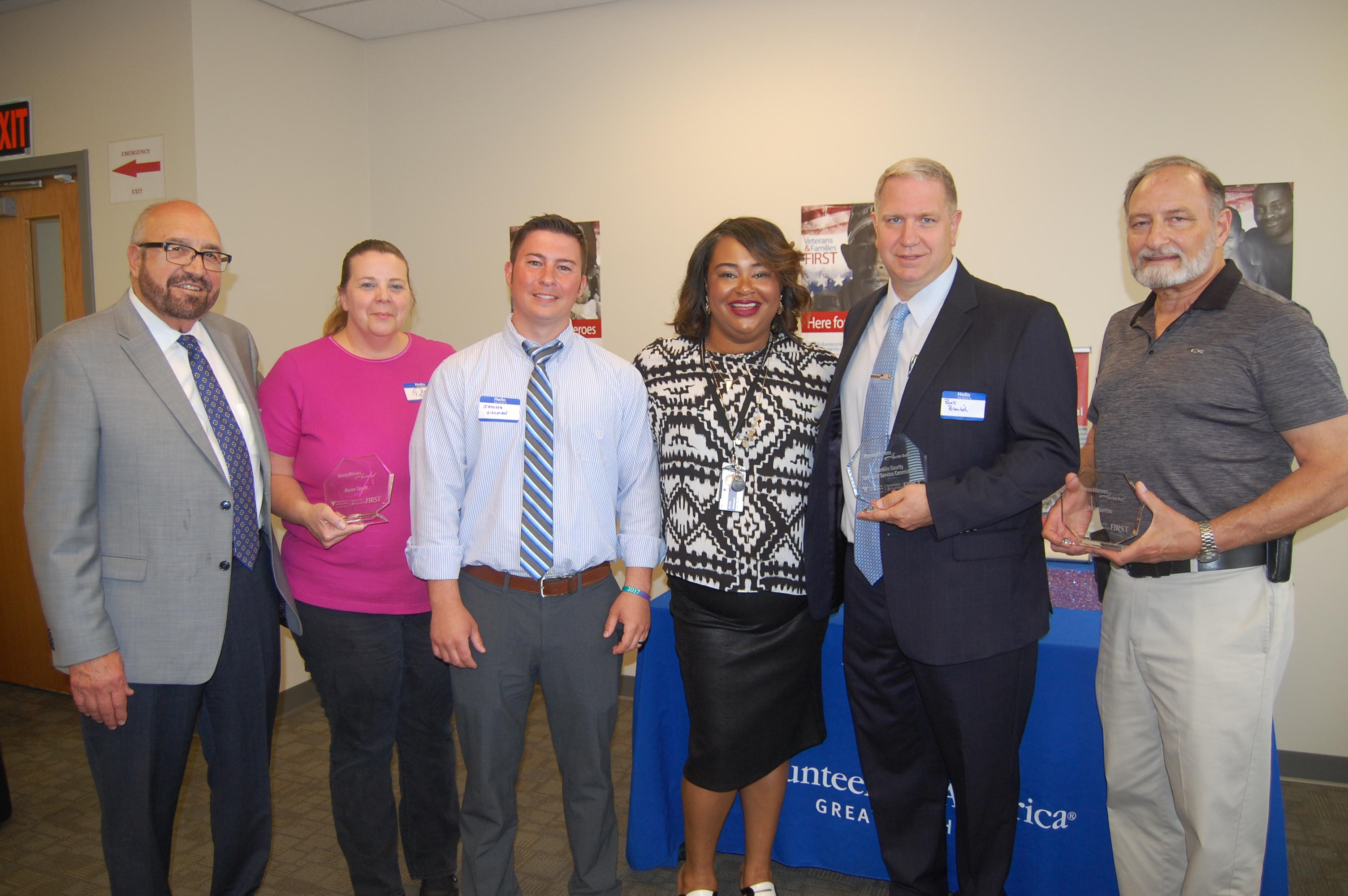 Dennis Kresak (President & CEO of Volunteers of America of Greater Ohio), Diane Sellers (Marion Square), Jascha L. Vissman (Franklin County Veteran Service Commission), Arica Morgan (Program Director of Columbus Veterans Programs at Volunteers of America of Greater Ohio), Robert Bramlish (Executive Director of Franklin County Veteran Service Commission) and Nick Kontras.