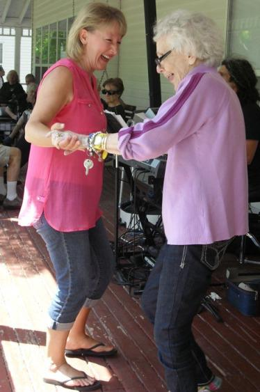Volunteers_of_America_Elder_Homestead_Staff_memember_dancing_with_a_senior_citizen_resident.jpg