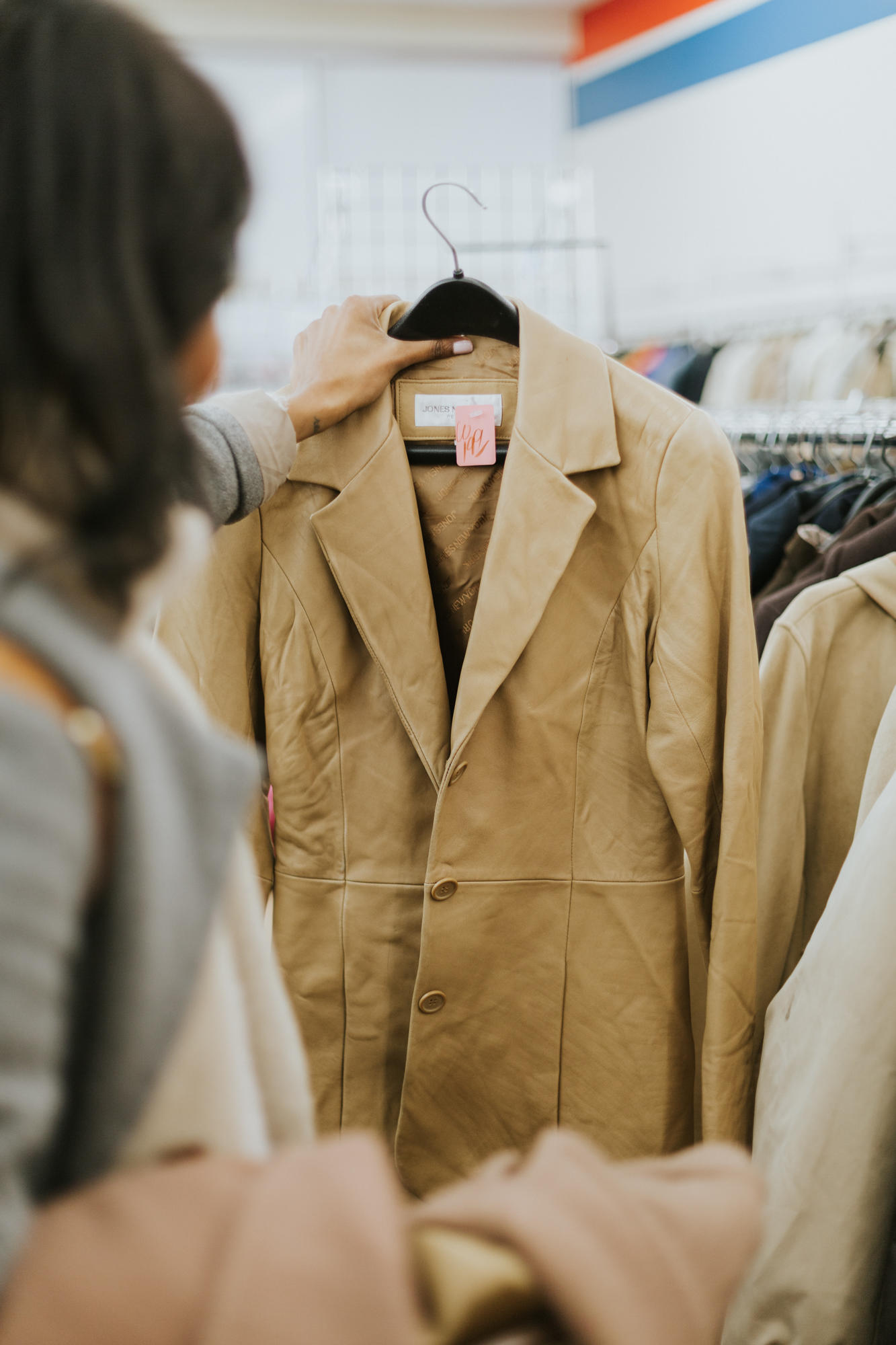 searching for the perfect jacket in thrift store