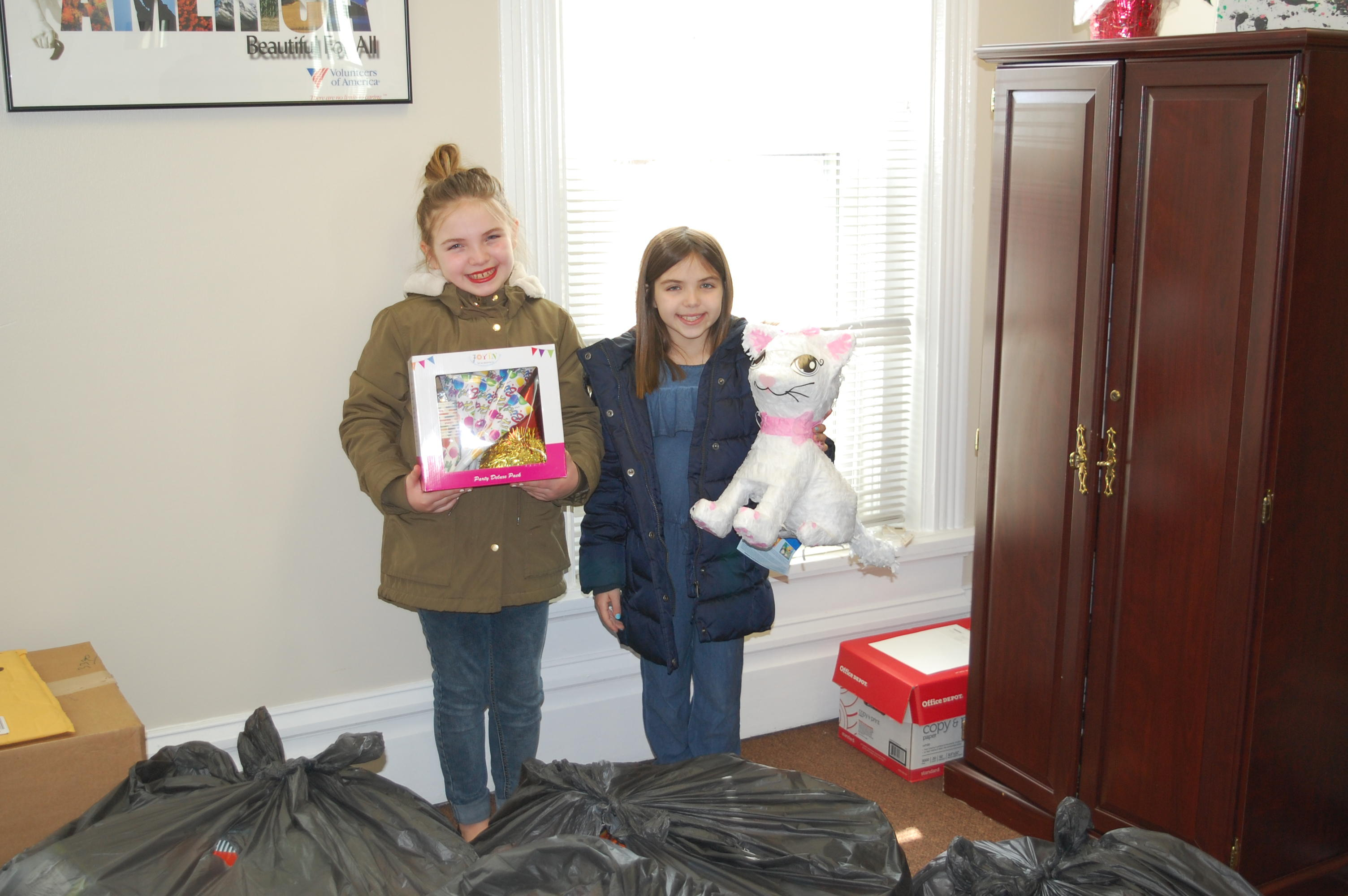 Columbus sisters give back to children in need by donating birthday party supplies.