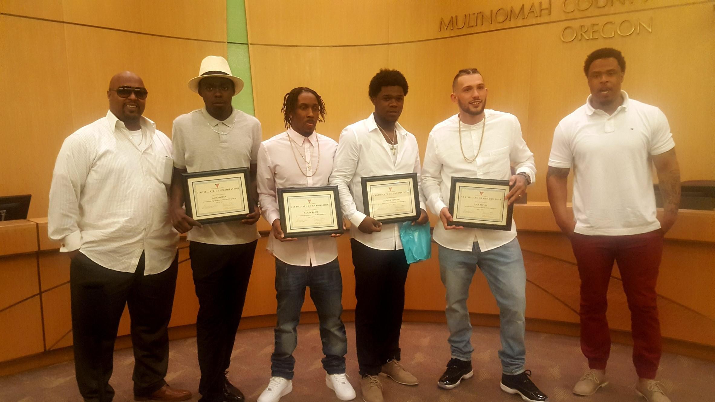 CPR graduates holding certificates