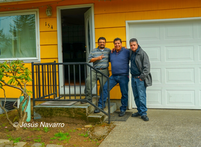 Three men standing in front of LHBR house
