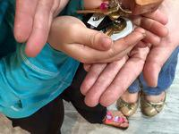 Previously homeless veteran and her daughter with keys to their new apartment