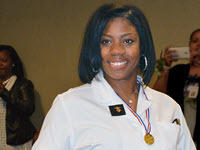 Christine Rowsey, Volunteers of America Michigan Client with her nursing degree